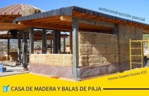 Casa de madera y balas de paja